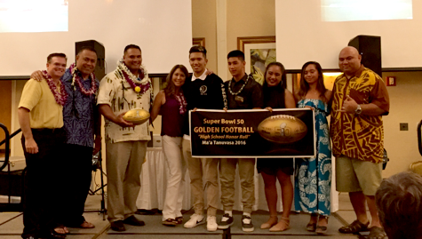 A golden moment: Tanuvasa receives football for 50th Super Bowl anniversary