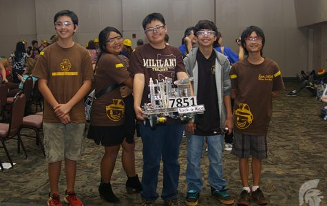 (L-R) Freshman Michael Caris Abagon, Sophomore Lauren Ceria, Juniors Allan Ching and Tyler Schafer and Freshman Tyler Yoshioka of Team 7851 after winning second place in the FTC competition.