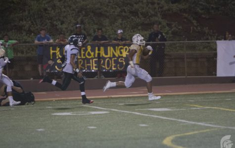 (Matthew Kawamoto | Trojan Times) At this year's Homecoming Game, Running Back Vavae Malepeai (12) added 65 receiving and 56 rushing yards to create a total record of 106 completed yards for this season and 639 completed yards for his high school career.