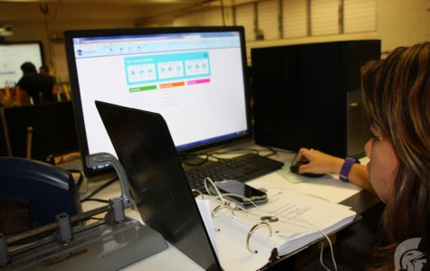 (Caitlyn Resurreccion | Trojan Times) Keri Shigeta (12) works on MyQuest, an online skills-based practice program, which tracks the students' learning in science, technology, engineering and mathematics (STEM). MyQuest will be used by students throughout the year and the progress will help determine the areas the student can improve on.