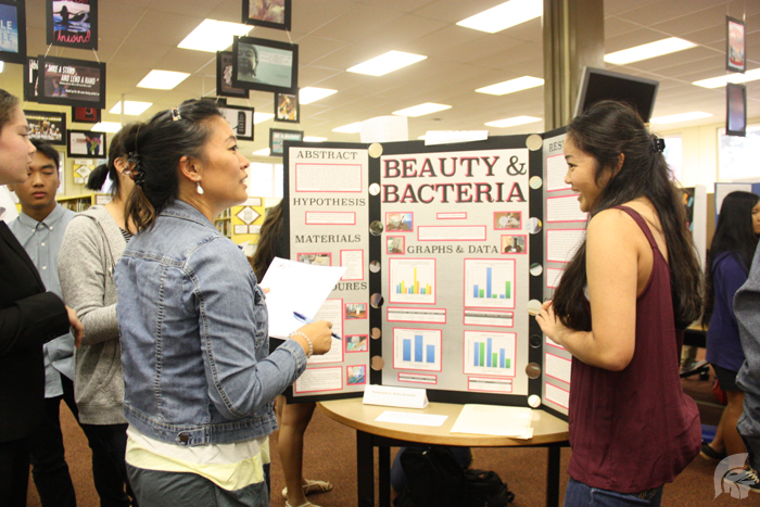 (Danielle Smith | Trojan Times) (L-R): Jeni Nishimura and Kelsea Hernandez-Young (12). While most of the projects were done independently, students were still able to gain the help of their science teachers in hope of perfecting their projects completely.
