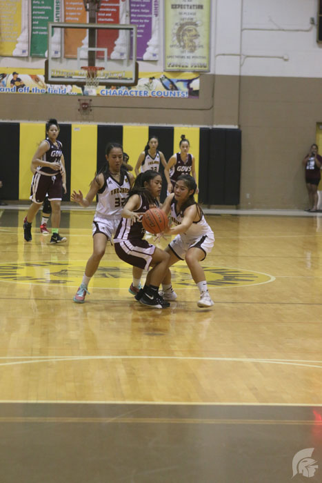 (Scott Alquisa | Na Manao Poina Ole) Defending against Farrington, Guard Jazmina Lafitaga (12) holds the team together, as a supportive leader on and off the courts.
