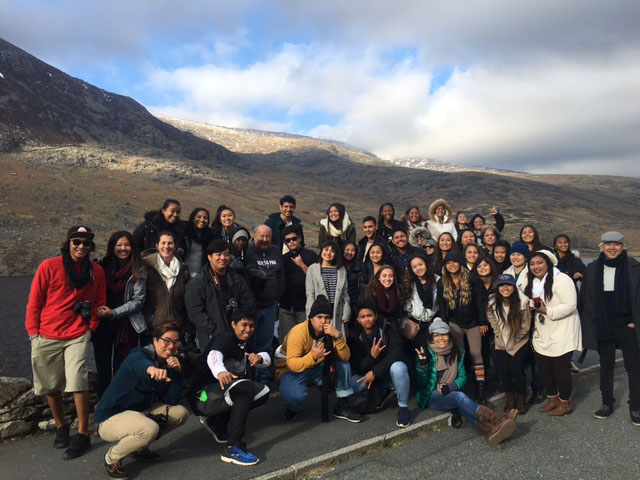 (Photo courtesy of Ruth Ravina-Koethe) Posing in the scenic country, the group of students manage to fit a quick group picture in their busy, adventure-packed schedule.