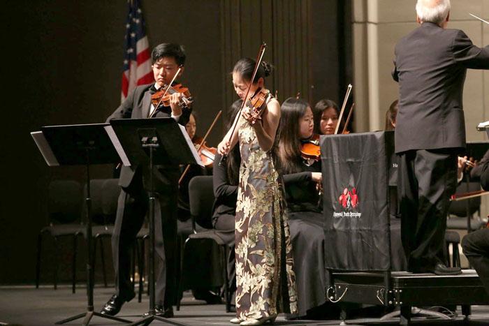 (Photos courtesy of Natalie Nakasone | Hawaii Youth Symphony) Along with Joseph Fujinami (12), Shin Chang, assistant-concertmaster of Youth Symphony I, and Angela Yang, concertmaster of Youth Symphony II, performed with Midori.