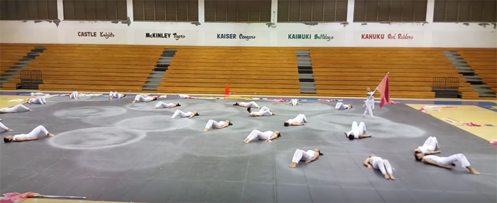 "(Photo courtesy of Jerika Gomez (12)) After months of training, the winter guard performed their winter number, ""Redemption"" on April 1 at the Kaimuki High School gymnasium."