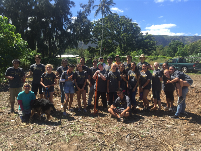 """(Photo courtesy of Saige Alip (12)) In Camp Mokuleia's """"Garden of Hope"""" each plant has a significant meaning and is deliberately placed. The staff took time to explain this significance to the various MHS Choir volunteers during their last trip in November."""