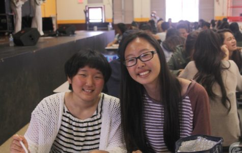 (Anika Ramos | Trojan Times) Kana Yokoyama, left, sits with Kana Morita (11), right, as part of the exchange program between Fuchu High School and MHS. The Japanese exchange students immersed themselves in Hawaii's culture during their stay.