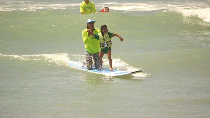 (Photo courtesy of Lt. Col. Timothy Schiller Sr. ) Instructors, in addition to the MHS students and Access Surf members, also participated in teaching children and adults how to surf and swim.
